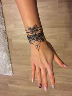 Mandala bracelet tattoo with bow