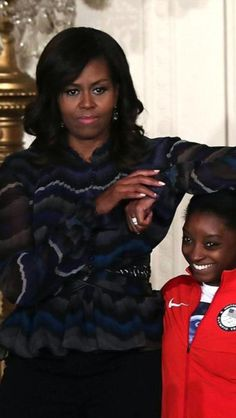 President Of The United States, Barack Obama & First Lady Of The United States, Michelle Obama, welcomed the 2016 US Olympic and Paralympic teams to the White House on Thursday September 29, 2016 to celebrate their record breaking run in Rio. FLOTUS pictured here with gold medal winning gymnast, Simone Biles (for the record, I hate when tall people do that to me).
