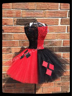 Harley Quinn inspired tutu dress. Available to a girls size 8. Add me on Facebook at Facebook.com/lisastutucuteboutique lisastutus.etsy.com