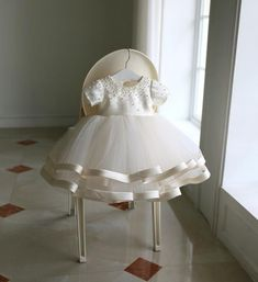 Shop High-end Beaded Ivory Puffy Flower Girl Dress Pageant Gown With Sleeves online. Super cute styles with couture high quality. Girls Dresses Online, Girls Party Dress, Little Girl Dresses, Baby Dress, Ruffle Dress, Flower Girls, Flower Girl Dresses, Christening Gowns, Gowns With Sleeves