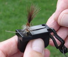 Device for threading a fishing lure magnetically. With age vision tends to decline and this device will enable leisure activities to prolong with this assistive device.   Photo by fly-fishing-discounters.com