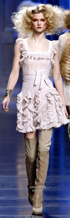 Christian Dior Fall 2010...I leave everything about this, the hair and bad ass boots!