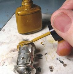 BENCH TIP  by Brad Smith | Store yellow ochre in empty fingernail bottles.  Yellow ochre is used when you want to be sure the solder will not flow onto an area of your piece while  you're soldering on another area. The only problem with ochre is coming up with a  good way to store and apply it. Recycled nail polish bottles seal well and have a built-in brush. Prior to re-use, clean out with a little acetone or nail polish remover, and its ready to go…