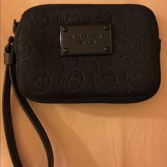Authentic Michael Kors wristlet Authentic small black on black (outside) Michael Kors wristlet. Camel color suede inside. Great condition; only flaw is the S on the outside is a little worn as shown in the last picture, but otherwise it's perfect! Approximately 4x5.25✨ Michael Kors Bags Clutches & Wristlets