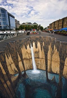 "Known for his impressive 3D pavement art, Edgar Mueller created this gigantic chasm for the West India Quay Festival in London. Mueller derives some of his inspiration from the ""Ice Age"" films."