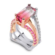 Just Out!!! This gorgeous Bi-Color Tourmaline is accented with Pink Sapphires and White Diamonds. It is set in both 18k Rose Gold and Platinum.