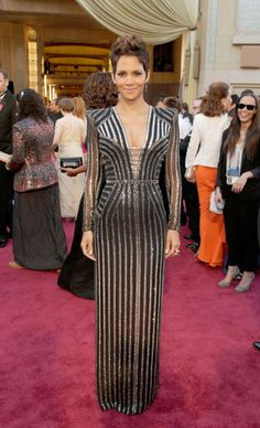 Halle Berry in a shining Versace long-sleeve gown.    Read more: Oscars Red Carpet 2013 - Pictures from 2013 Academy Awards Red Carpet - Harper's BAZAAR