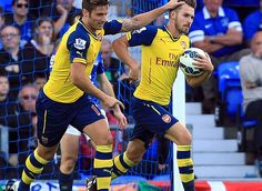 One back: Aaron Ramsey grabs the ball after scoring the goal that got Arsenal back into the game. First arsenal game I ever watched :)
