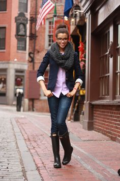 Rain boots over jeans with a blazer.