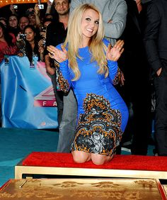 Britney cements her handprints and signature at The X Factor screening in Hollywood at the Grauman's Chinese Theatre.
