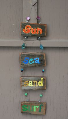 SuN SeA SanD SurF Driftwood Art with colorful glass beads. $20.00, via Etsy.