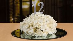 White hydrangea flowers with table number