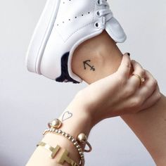 Heart tattoo on Mellis wrist and anchor tattoo on the...