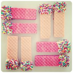 theurchincollective.  Sugar wafers dipped in melted chocolate and coated with sprinkles.