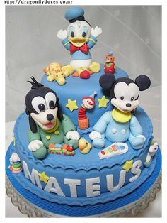A cake with Disney's Mickey, Goofy and Donald Duck (in their baby version) figures, made with gumpaste. The characters belong to Disney. The cake a. Mickey And Minnie Cake, Bolo Minnie, Crazy Cakes, Birthday Cake Decorating, Cookie Decorating, Mom Cake, Fancy Desserts, Disney Cakes, Breakfast Cake