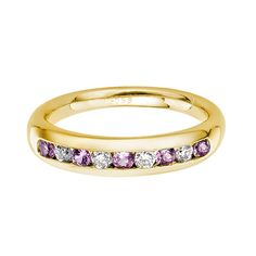 A pink sapphire and diamond half eternity ring, alternately set with round brilliant cut diamonds, combined weight 0.15-0.40 ct*, and pink sapphires, combined weight 0.20-0.45 ct*, mounted in an 18ct yellow gold channel setting, bandwidth 3.5mm. * Ring size dependant