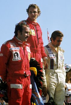 Niki Lauda, Clay Regazzoni and Carlos Reutemann. I wonder when this picture has been taken (guessing 1975 Swedish Grand Prix when Lauda won, Reutemann was second and Regazzoni third) and why they seem to be so serious. They are standing at podium but no one seems to be especially happy about it...
