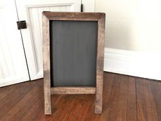 @Mary Felix great tutorial for a DIY large chalkboard easel. Maybe we can make them ourselves! Cost is around $15