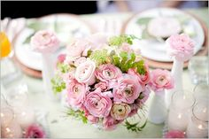 pink centerpieces with milk glass
