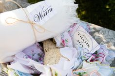 Guests were welcomed with keepsake items of cozy white blankets and handkerchiefs at Holly and Nancy's ceremony site. Photo credit: Ralph Alswang Photography How cute! Find blankets like this for rent and/or sale at splendorforyourguests.com! Splendor for Your Guests | Rental Company | Weddings | Events | Shawls | Blankets | Umbrellas | Parasols | Fans