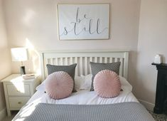 Beautiful Blush bedroom with oversized print above bed. Hints of Grey, Black and White with Brass accessories. Oliver Bonus cushions, table lightly Made.com.