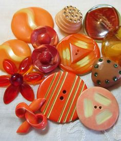 vintage orange Celluloid buttons - some great angles in this bunch