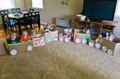 Cardboard box train.  Great for a train birthday party theme! - like the addition of paper plates for wheels