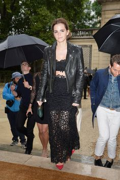 Here are some people awkwardly holding umbrellas while Emma struts up the stairs like a goddess. | 23 Times Emma Watson Made Everyone Around Her Look Painfully Average