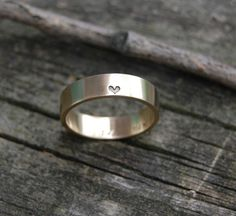pretty wedding band...i just want to wear it because of the teeny heart!