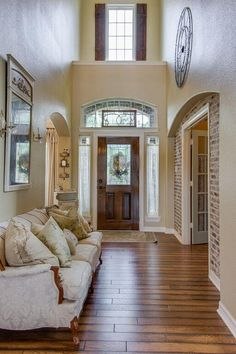 French Country two story foyer with shutters.