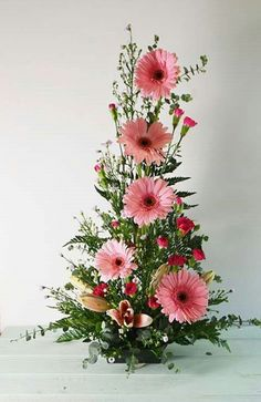 symmetrical front facing arrangement with Gerbera Daisies, mini carnations, and spiral eucalyptus. Altar Flowers, Church Flowers, Funeral Flowers, Easter Flower Arrangements, Beautiful Flower Arrangements, Floral Arrangements, Ikebana, Fresh Flowers, Silk Flowers