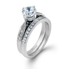 This gorgeous 18K white engagement ring and band is comprised of .34ctw round white Diamonds.
