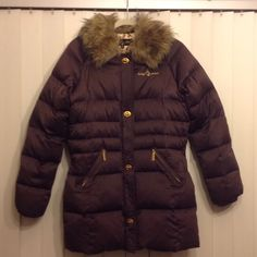 Baby Phat - Down Jacket Super sharp, Authentic Jacket by Baby Phat is a size Large. And in near New condition. This coat is 50% Down and 50% Feathers. Beautiful chocolate brown body with awesome Gold details: front & pocket zippers, the Baby Phat signature on the shoulder and the Gold fasteners. The luxurious lining is breathtaking and very pretty! Lastly, the Fur Collar...Well ladies, it's removable.! This Fur collar adds great personality  Priced 'low' so NO 'low' offers (please!) btw, the…