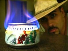 Soda Can Stove... And here's a gif of one being made: http://i.imgur.com/n63DN.gif