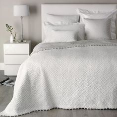 Pure white bed.
