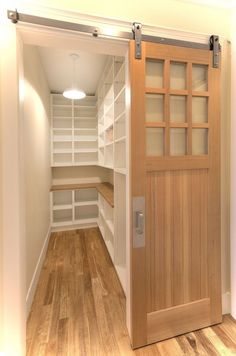 Like this sliding barn door opening to a spacious walk-in pantry. More designs at www.HomeChannelTV.com
