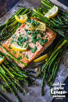 Sheet Pan Lemon Garlic Salmon and Asparagus is a light, delicious, and easy dish bursting with flavor! Healthy and great for a family. I LOVE salmon. And asparagus. I also love simple, easy meals Entree Recipes, Seafood Recipes, Dinner Recipes, Cooking Recipes, Healthy Recipes, Pan Cooking, Healthy Dishes, Delicious Recipes, Lemon Garlic Salmon