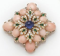 A Coral and Gem-Set Brooch, David Webb the Lozenge-Shaped Panel Centering an Oval Cabochon Sapphire, Diamond and Emerald Cluster within a Surround of Oval Cabochon Pink Coral and Further Accented with an Emerald and Diamond Border; Sighed David Webb; Estimated Total Diamond Weight: 5.00 Carats; Mounted in Eighteen Karat Gold.