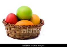 Royalty free stock photography from Alamy: Basket with Easter eggs isolated on white background.