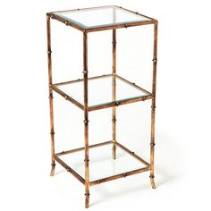 """This side table's Chinoiserie-inspired antique gold faux bamboo frame in forged iron boasts classic style with a refined, modern edge. Looks gorgeous next to your favorite chair. The well-proportioned table will accommodate your favorite book, object, or vase and sits at the ready for any incidentals.  14"""" Sq.x 31"""" H Iron/Beveled Glass Antique goldfinish   Estimated Ship Date:Usually ships in 7-10business days.   Delivery Method:Ships via Standard Ground Service. Pleasecontact usfor…"""