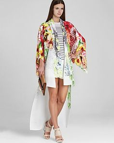 Go global in the eastern-inspired style of this Bcbgmaxazria kimono wrap. Bedecked in a floral print, this oversize knit brings cultured-chic to a striped dress and neutral heels. Swim Cover Ups, Striped Dress, Night Gown, Beachwear, Kimono Top, Floral Prints, Gowns, Chic, Shopping