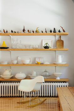 Utilitarian shelf supports combined with thicker, rough-hewn wood shelves.