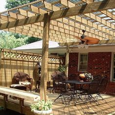 Pergolas are the grand-daddy of backyard shade.  With overhead slats they provide an abundance of cover  Add an energy-wise panel on top, a cloth canopy, hanging plants or vines, and a pergola does double-duty for sun protection. | What's the difference between an arbor, trellis and pergola?