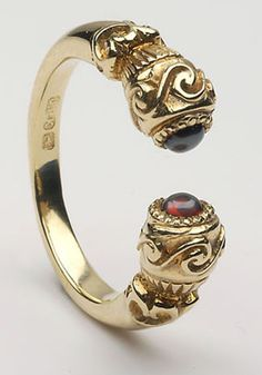 I bought this Antique Celtic Ring from Ireland years ago, quite a fantastic ring!  The Torc Ring, was an important piece of Celtic jewelry, and was worn before 1200 BC to as late as 600 AD. It was a powerful symbol, perhaps representing the wearer's free-born status.