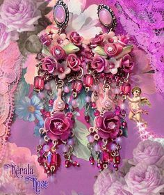 These Hand-painted Pink & Red Floral Gypsy Rose Victorian Chandelier Earrings are made with hand-painted roses, glass flowers, Swarovski rhinestones, pink opal glass beads, red crystal and Ruby Swarovski jewels. All of the brass stampings have been painted with red and peach shades. A pretty