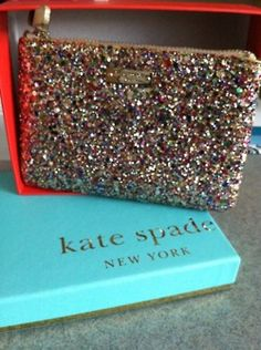 Kate Spade Glitter Wristlet. happy holidays/birthday to me! :)