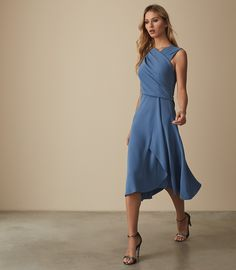 The Marling midi dress in mid-blue is artfully designed with a slash  neckline 56c14ccaf