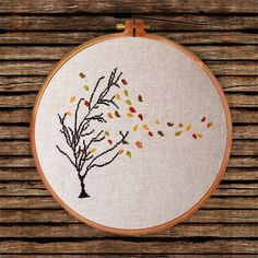 lovely autumn tree with falling leaves in the wind, instant download pattern can be found at https://www.etsy.com/listing/244084907/autumn-tree-cross-stitch-pattern-modern?ref=shop_home_active_4&ga_search_query=autumn%2Btree