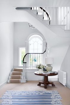 This image shows transition because it is white and has round windows. This makes the room look so much softer and a place that u would dream of having in your own house. The stairs lead up to the room with the round stairs which helps make the room calmer.