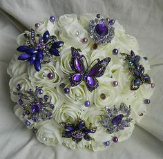 Ivory Brooch and Flower Bouquets | Stunning Wedding flowers vintage brides brooch bouquet ivory cadbury ...